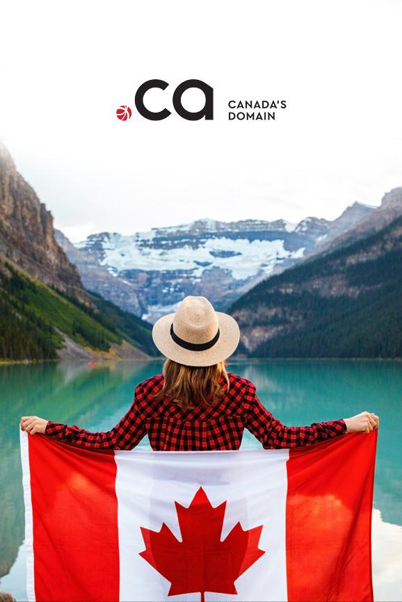 Woman holding Canadian flag looking at the mountains